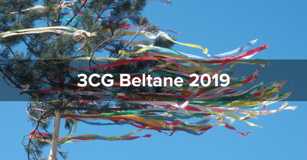 "Brightly colored ribbons stream from a small pine tree against a clear blue sky. The words ""3CG Beltane 2019"" are superimposed."