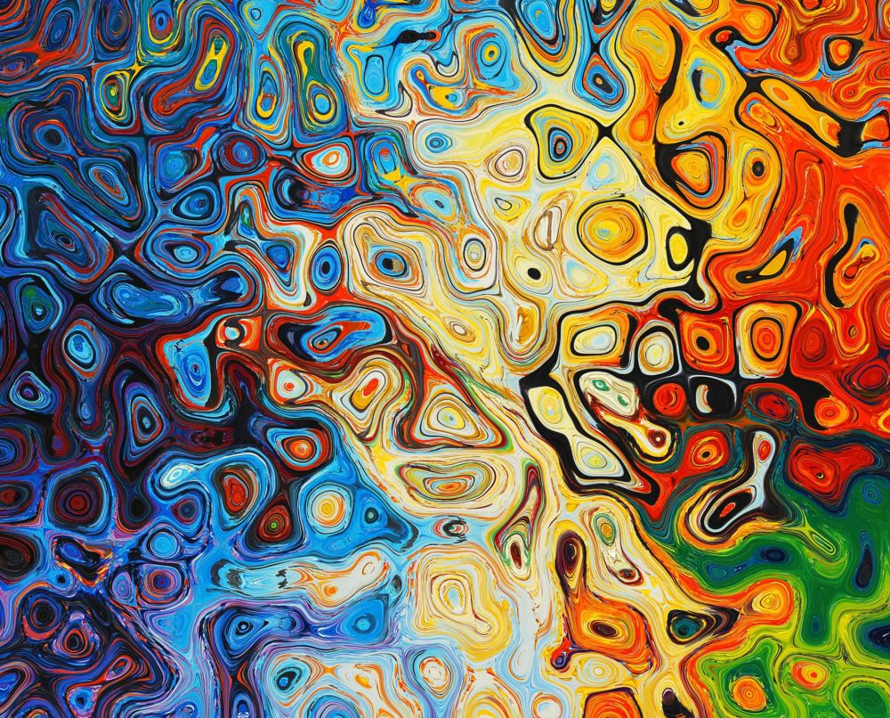 An abstract swirl of colors, fading from blue to yellow to red and green as you scan from left to right.