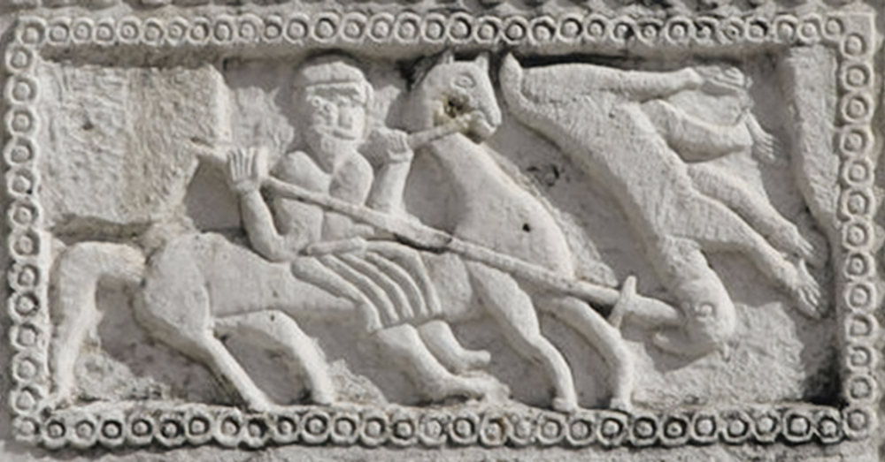 In a bas-relief stone carving, Perun reaches forth from his chariot to spear Veles, represented as a stylized bear.